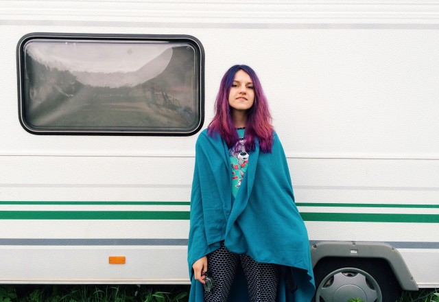 Hippie girl near caravan