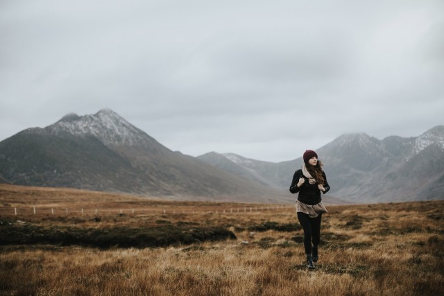 Girl hiking in mountains in Scotland