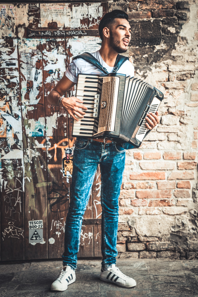 Young Man Accordion Music Player Performing In The Street