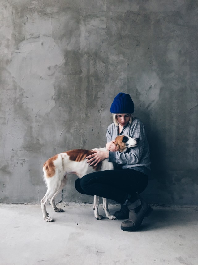 Girl with lonely dog
