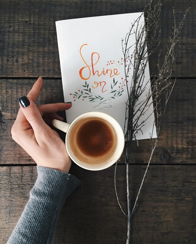 Flatlay with lettering card on wooden background