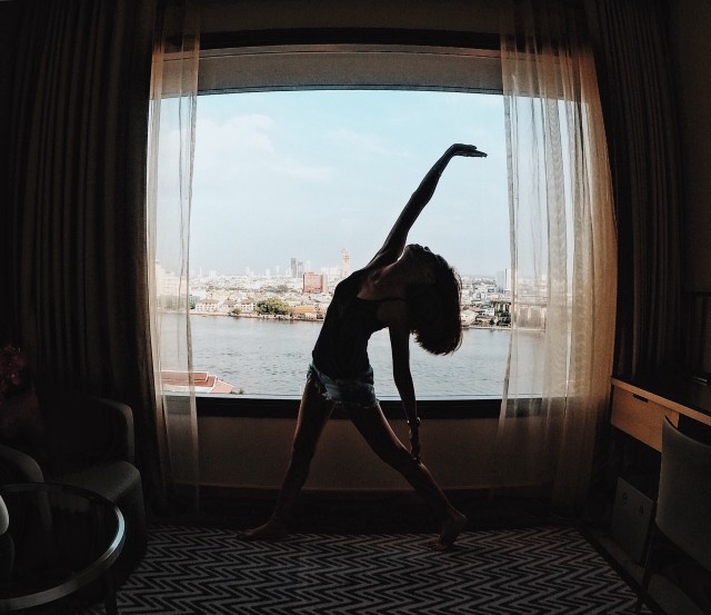 Yoga pose by the window.