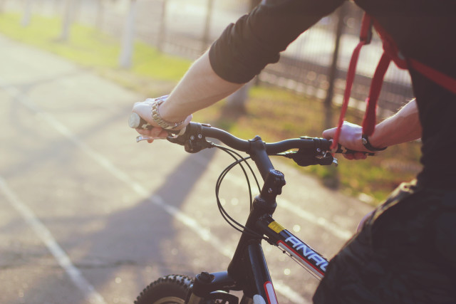 Free stock photo of Man riding a bike - Reshot