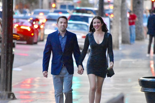 Happy couple walking up the street