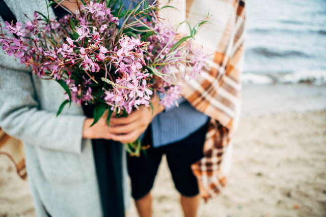 Free authentic holding flowers photo on Reshot