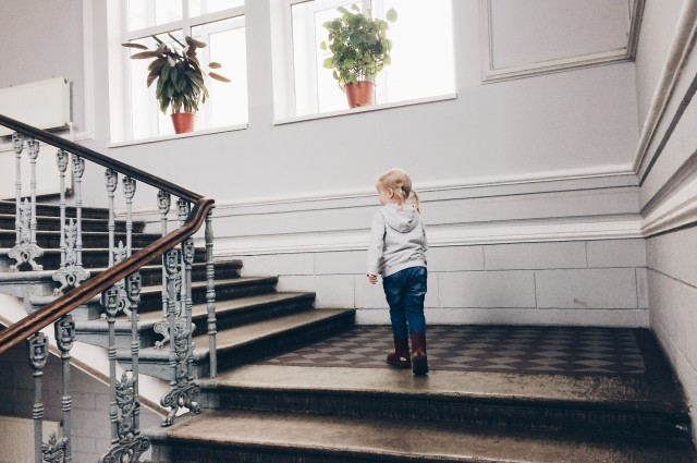 Little girl on the stairs