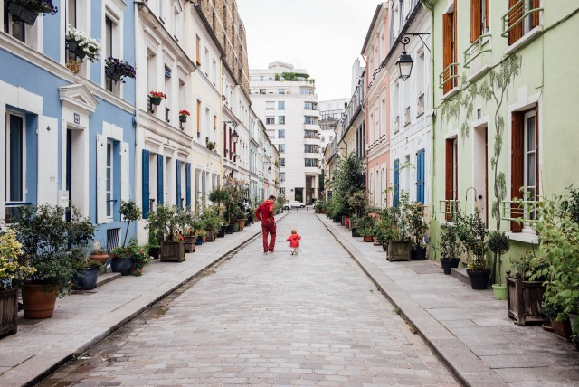 Paris, rue Crémieux. Red dad and daughter.