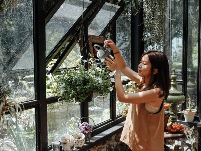 Woman in glasshouse