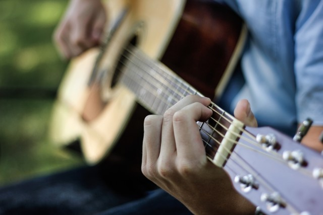 Man playing guitar outside