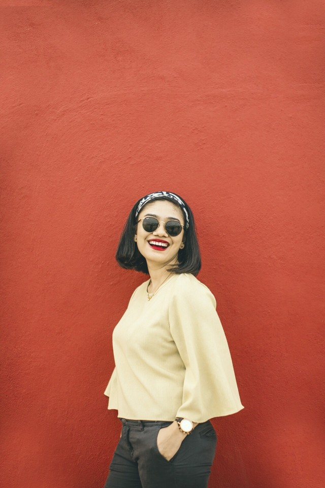 Summer Fashion Women in the red wall with smile