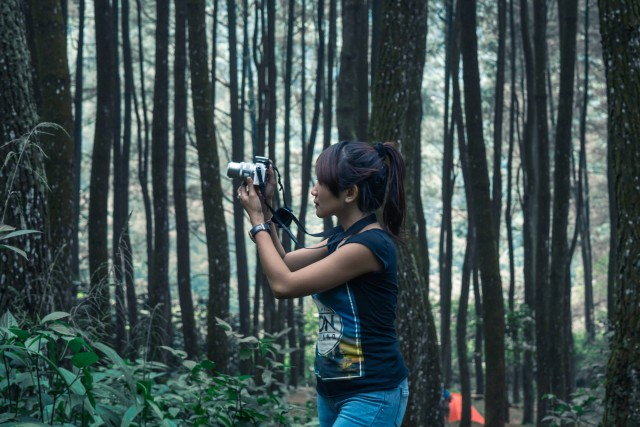 girl with camera on the forest
