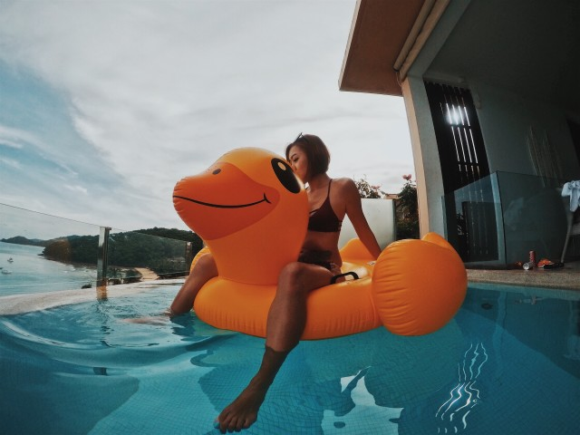 Woman sitting on a giant duck inflatable!