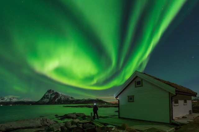 Admiring the show of the Northern Lights in Lofoten Islands, Norway