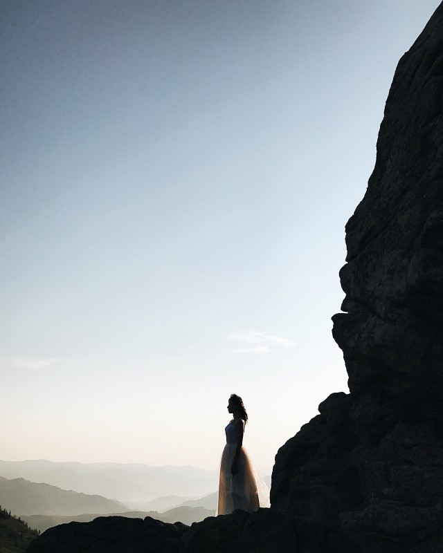 Bride silhouette in the mountains