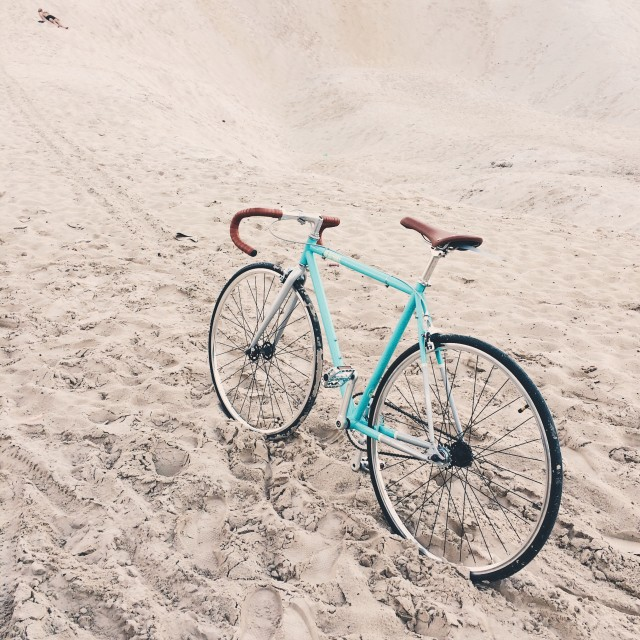 Retro bike on a sand background