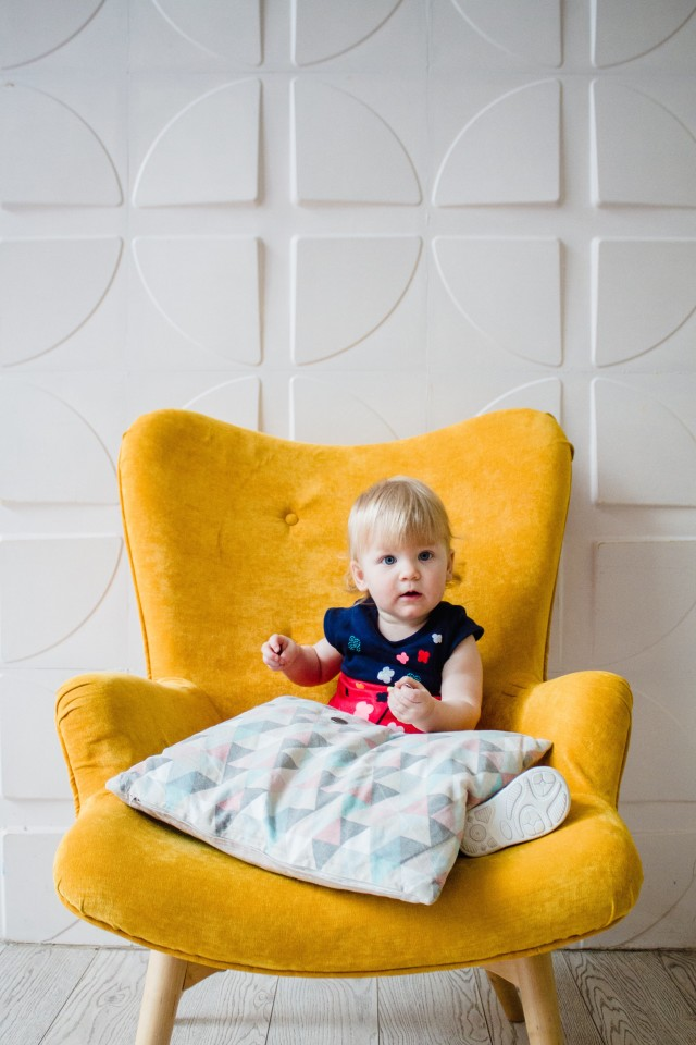 Baby on yellow chair