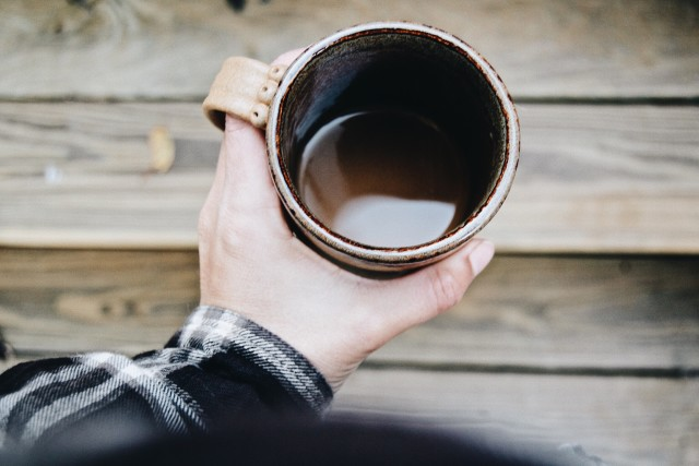 Drinking coffee at a cabin