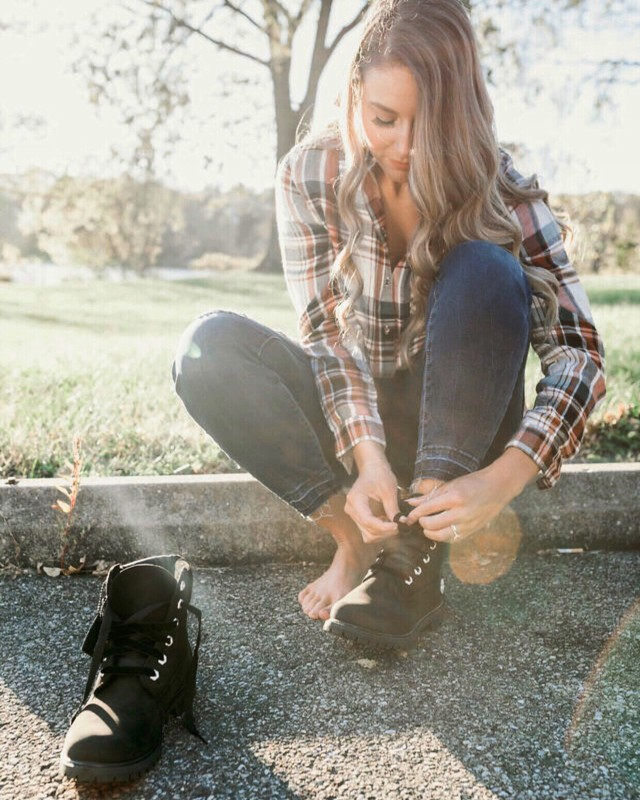Young woman lacing boots for fall!