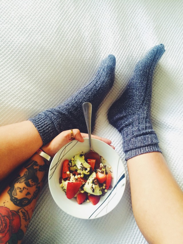 Bowl of fruit in bed