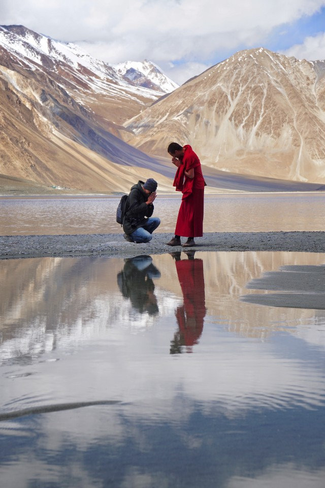 Buddhist man pay respect to monk at Pangong lake, Ladakh, Jammu and Kashmir, India.