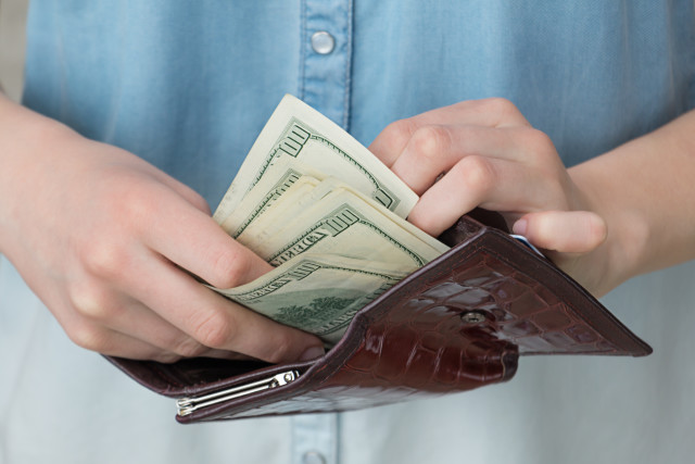 A girl with a wallet in her hands, business, savings, investment, paper, banking, financial, bank, hand, human, closeup, concept, buy, person, woman, success, bill, economy, paying, debt, pay, count, banknote, holding, exchange, table, usa, payment, salary, american, budget, loan, earnings, accounting, income, usd, stack, profit, girl, giving, greed, people, shopping, close-up, calculate, purchase, save, earning, donation, prosperity, lifestyle, report, workplace, home, account, invest, amount, luck, heap