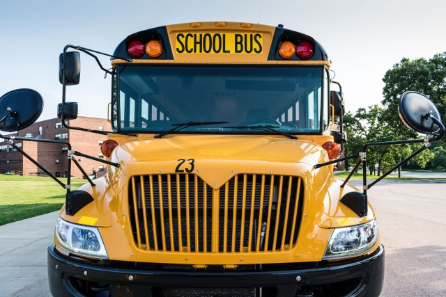 Front view of a school bus -   Bus line up, back to school, pick up, drop off, high school, junior high, middle school, elementary, grade school, public school, transportation, field trips, sporting events, team, band, kids, teens, students  💫