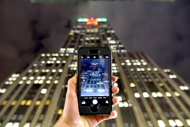 Empire State Building being captured by a smart phone camera.