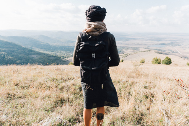 Woman from behind looking at the epic view