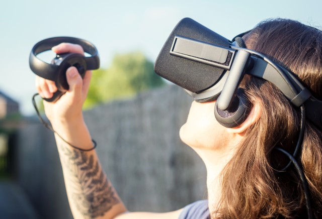 Virtual reality, VR, 3D, game, gamer, gaming, woman, playing, augmented reality, looking up, gadgets, tattoo, backyard, outdoors, future, technology, hologram, holding, closeup, helmet, visual, view, headset, innovation, glasses, experience, digital, device, reality, stereoscopic