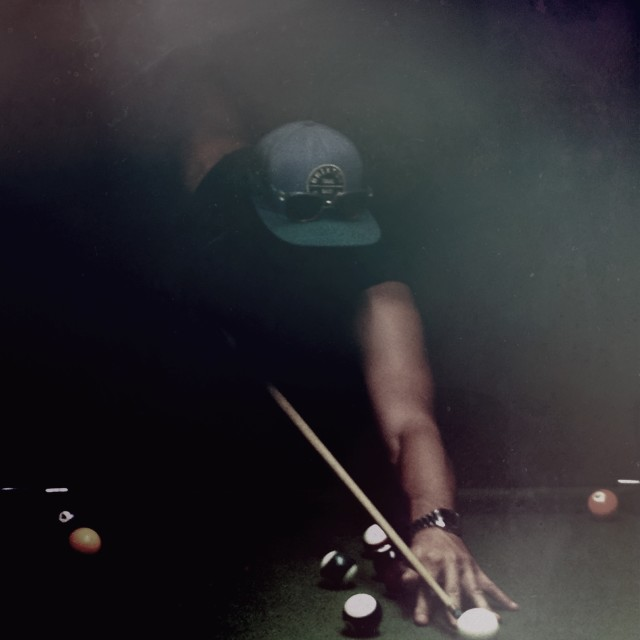 Snooker player in smoky bar