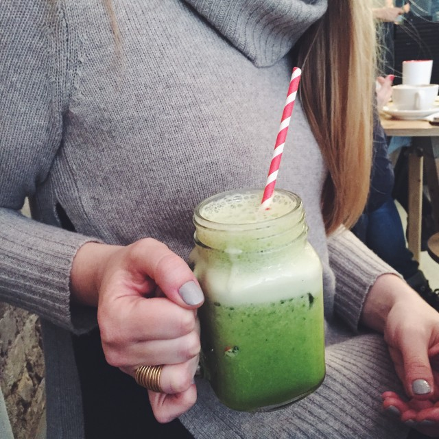 Girl in Sweater Drinking Green Juice