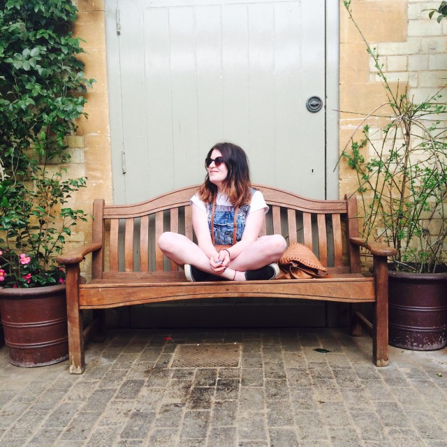 Loving life, sitting on a bench.