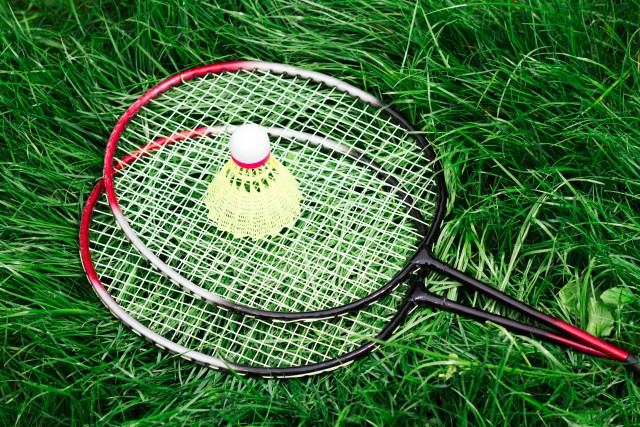 Badminton rackets on a grass