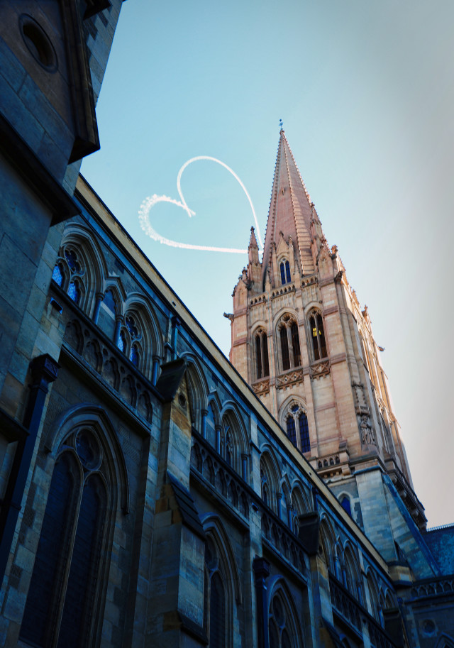 Sky writer writes heart over church building