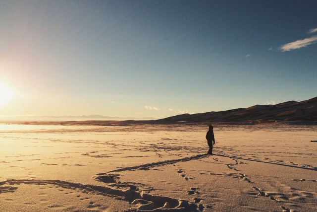 My Sister-In-Law wandering aimless lee in the snow of The Great Sand Dunes in Colorado