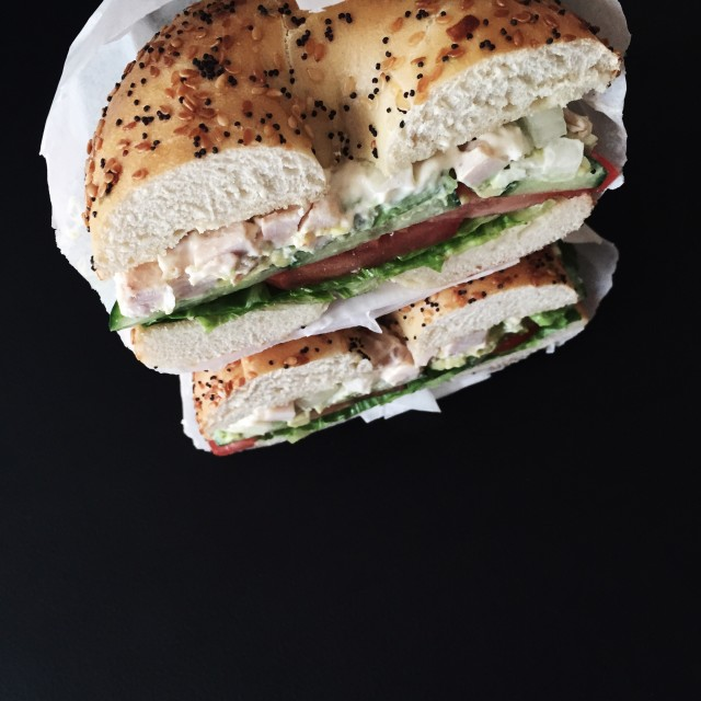 Top view of chicken salad bagel sandwich
