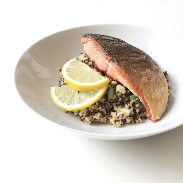 Close-up of pan-seared salmon with warm bulgur and quinoa salad