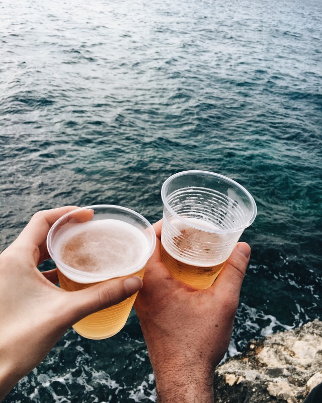 Drinking beer by the ocean