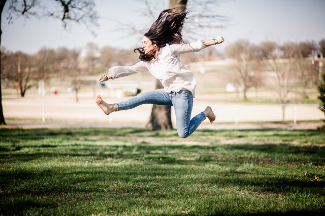 Woman jumping in air.