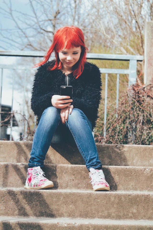 Girl with her phone
