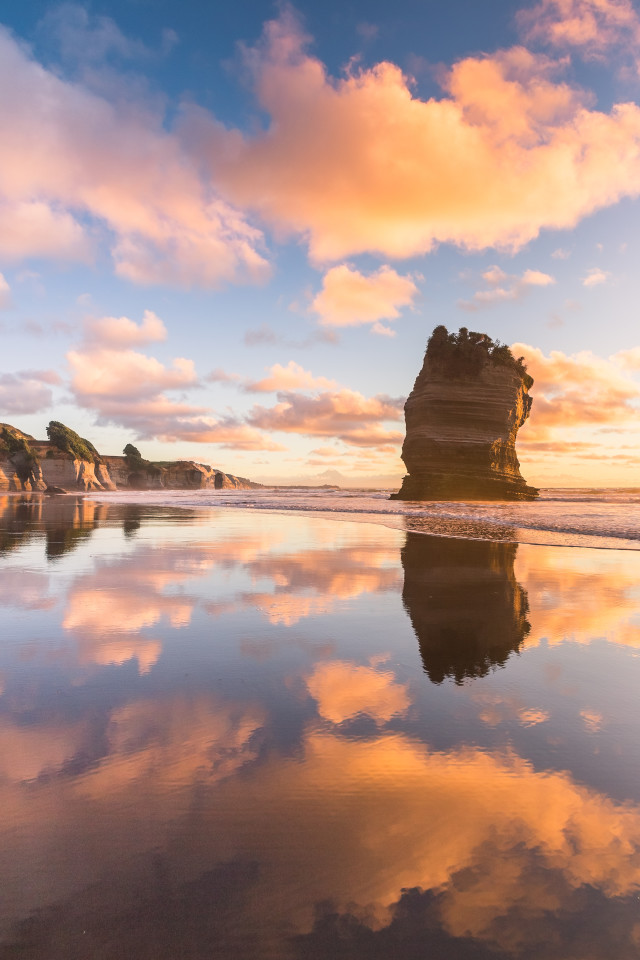 Three Sisters rock formation in Taranaki, New Zealand (in fact, there are only 2 of them left)