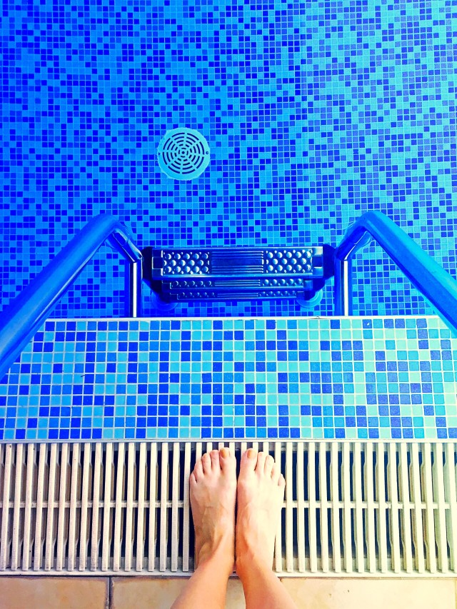 Feet by the pool.