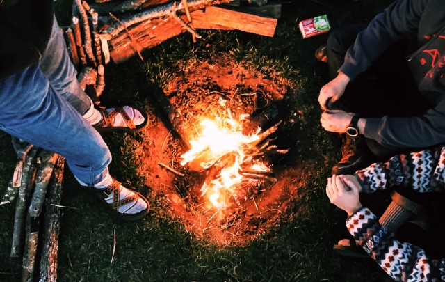 Over top of the camp fire.