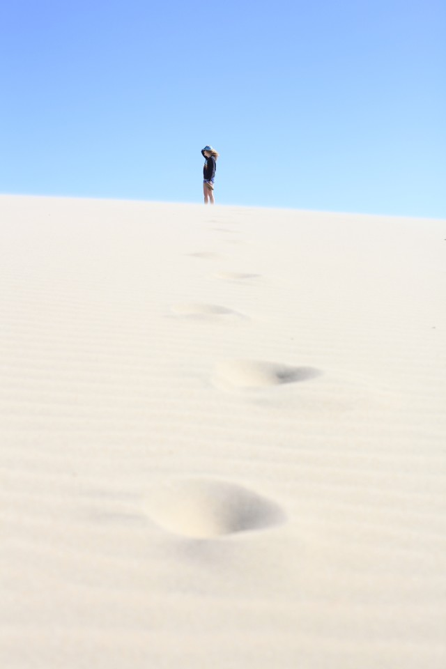 Climbing sand dunes leaving footprints