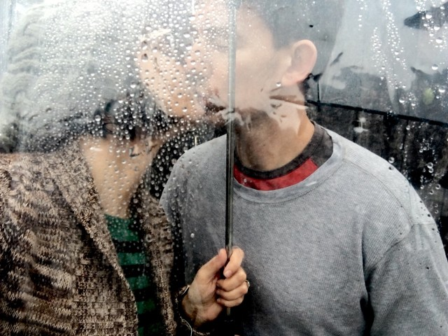 Kissing under the umbrella