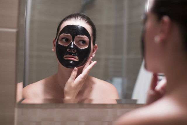 Woman with black mask in bathroom