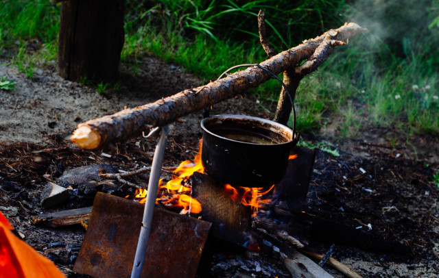 camping with tea on the fire