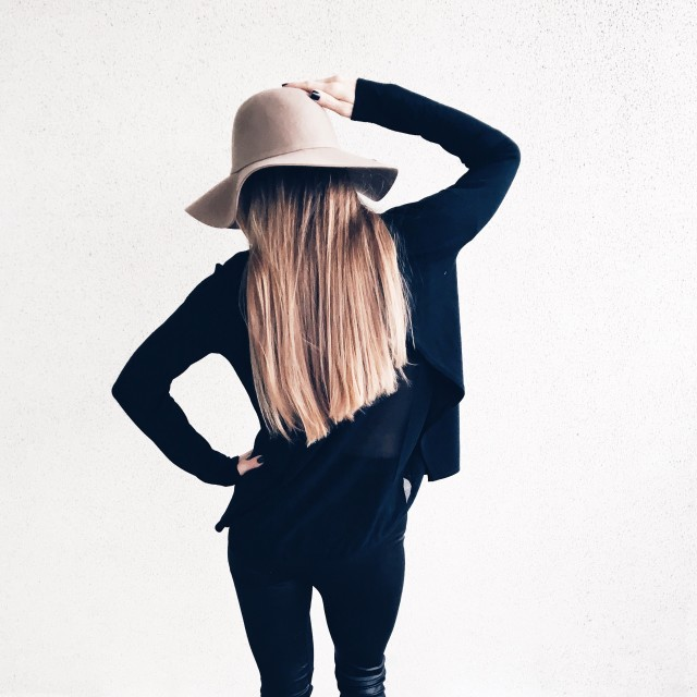 Stylish girl is wearing hat