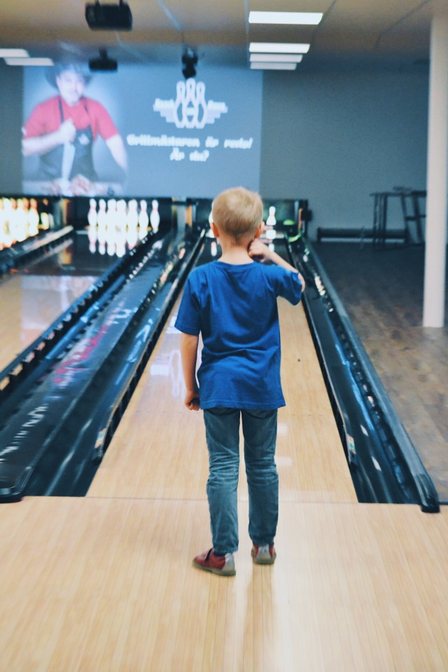 Boy playing bowling