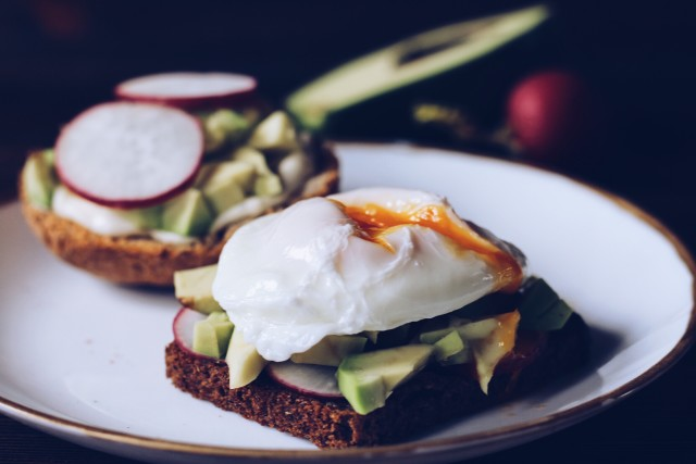 The sandwich with a garden radish, avocado and egg plows